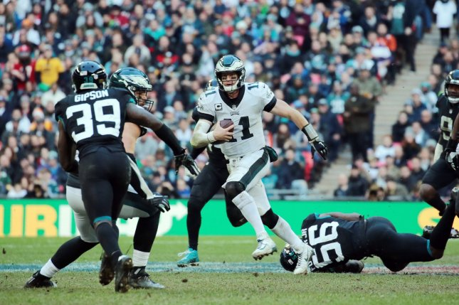 Philadelphia Eagles quarterback Carson Wentz runs with the football in an  NFL International Series match against the Jacksonville Jaguars on Sunday  at ... 9b3265bd7