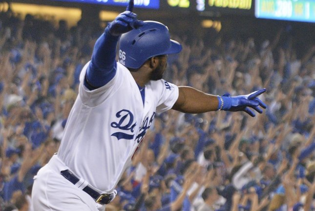 Los Angeles Dodgers right fielder Yasiel Puig celebrates his three-run home run against the Boston Red Sox during the sixth inning of Game 4 of the World Series on October 27 at Dodger Stadium in Los Angeles. Photo by Jim Ruymen/UPI