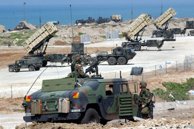 American soldiers guard Patriot anti-missile systems deployed in a joint US-Israeli military outpost in Jaffa, south of Tel Aviv. Debbie Hill/UPI