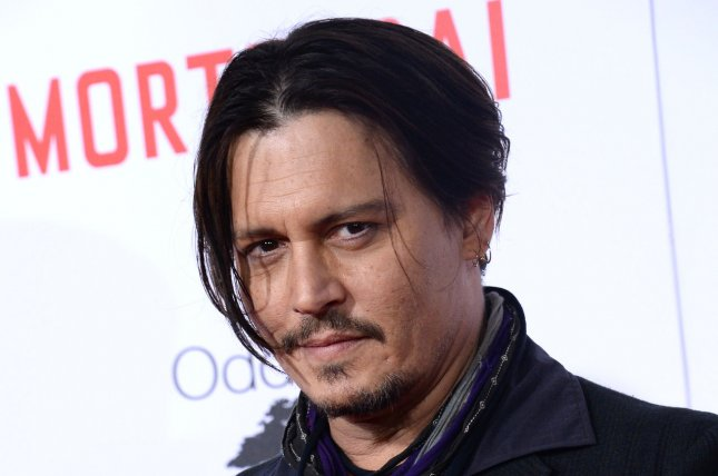 Cast member Johnny Depp attends the premiere of the motion picture comedy Mortdecai in Los Angeles on Jan. 21, 2015. File Photo by Jim Ruymen/UPI