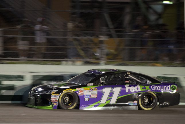 NASCAR Nationwide Series Championship racer Danny Hamlin (11) runs during qualifying for the Ford EcoBoost 400 at the Homestead-Miami Speedway in Homestead, Florida on November 20, 2015. Hamlin won the pole position with a speed of 176.655 mph. Photo By Gary I Rothstein/UPI