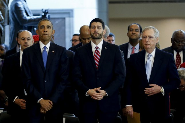 U.S. President Barack Obama stands next to Speaker of the House Paul Ryan (C) and Senate Majority Leader Mitch McConnell, after delivering remarks at an event commemorating the 150th anniversary of the 13th Amendment, which formally abolish slavery, on Capitol Hill, in Washington, D.C., on Wednesday. Lawmakers continue to work toward passing a new $1.1 trillion spending bill and avert a government shutdown. Pool photo by Aude Guerrucci/UPI