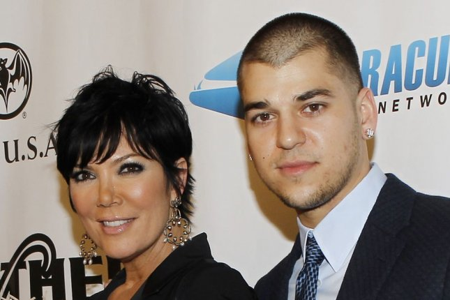 Kris Jenner (L) and son Rob Kardashian at the Leather and Laces party on February 5, 2010. The reality star reportedly bought Kardashian a home in her gated community. File Photo by John Angelillo/UPI