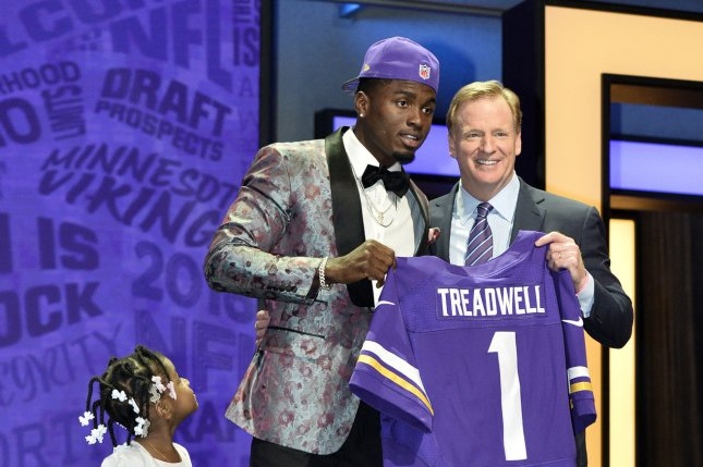 Ole Miss wide receiver Laquon Treadwell (C) poses with NFL Commissioner Roger Goodell with his daughter Madison, age 3, after being selected by the Minnesota Vikings with the 23rd overall pick in the 2016 NFL Draft on April 28, 2016 in Chicago. Photo by Brian Kersey/UPI
