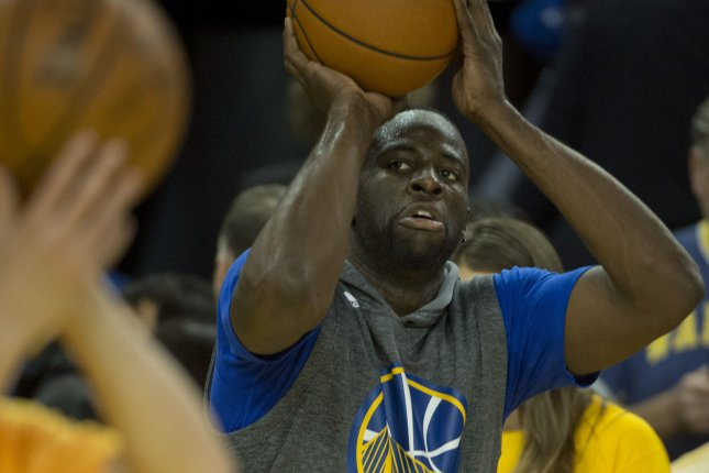 Golden State Warriors' Draymond Green warms up. Photo by Terry Schmitt/UPI