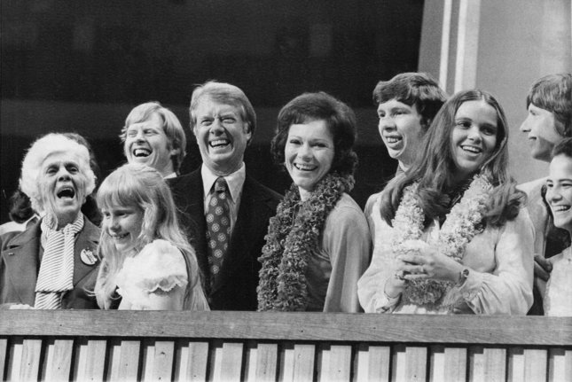 Democratic presidential nominee Jimmy Carter is surrounded by family after accepting his party's nomination on July 15, 1976, at the Democratic National Convention. UPI File Photo