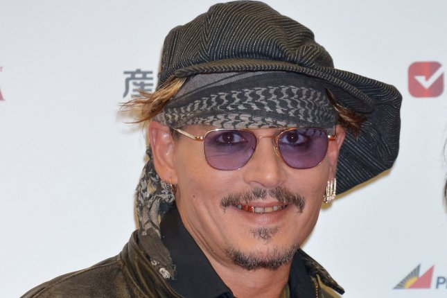 Actor Johnny Depp arrives on the red carpet for the Classic Rock Awards 2016 in Tokyo, Japan on November 11, 2016. File Photo by Keizo Mori/UPI