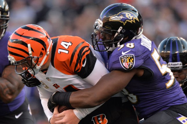 Cincinnati Bengals quarterback Andy Dalton is sacked by former Baltimore Ravens' Elvis Dumervil during the third quarter at M&T Bank Stadium in Baltimore, Maryland. File photo by Kevin Dietsch/UPI