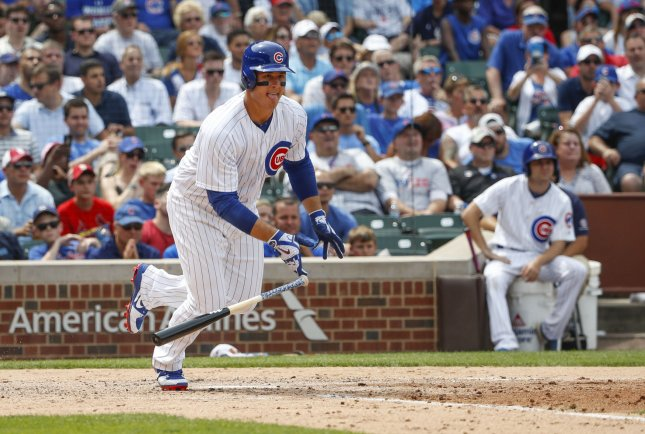 Anthony Rizzo of the Chicago Cubs hits an RBI single against the St. Louis Cardinals on Friday at Wrigley Field. Photo by Kamil Krzaczynski/UPI