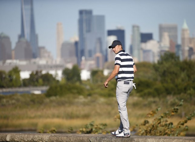 Jordan Spieth walks on a retaining wall on the 14th hole on Day One of the Presidents Cup on Thursday at Liberty National Golf Club in Jersey City, N.J. Photo by Rich Schultz/UPI
