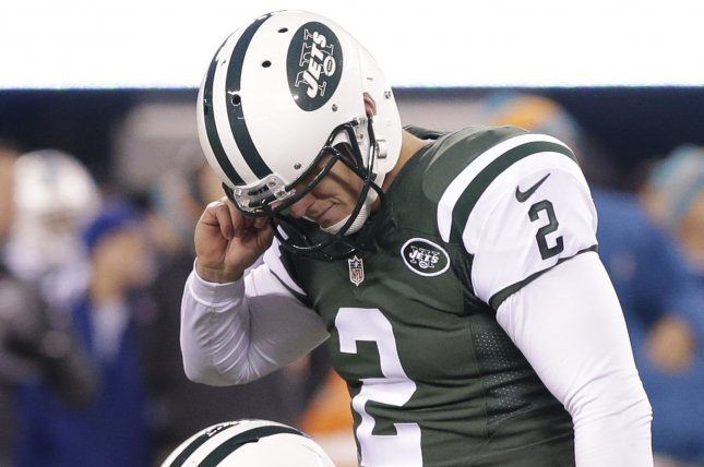 New York Jets' Ryan Quigley watches former Jets kicker Nick Folk react after missing a 45-yard field goal against the Miami Dolphins in the 4th quarter in week 13 of the NFL season at MetLife Stadium in East Rutherford, New Jersey. File photo by John Angelillo/UPI