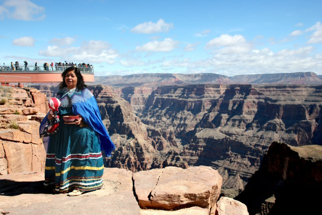 Hualapai tribal member Sylvia Quertz stands at the edge of the Grand Canyon in Grand Canyon West, Ariz., on March 28, 2007. On February 14, 1912, Arizona was admitted as the 48th member of the United States. File Photo by Art Foxall/UPI
