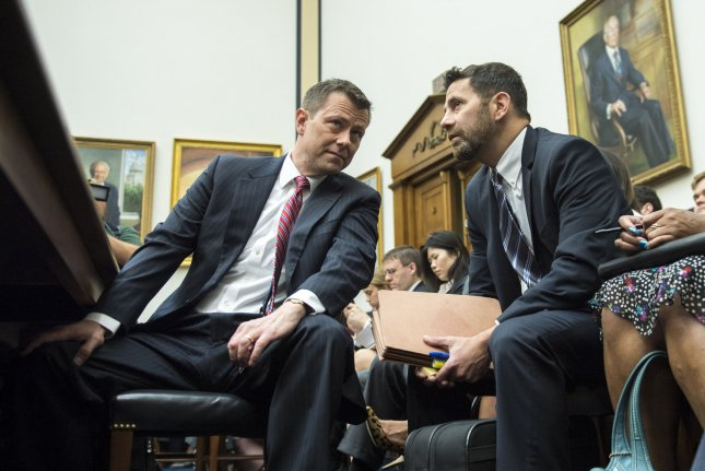 Former FBI agent Peter Strzok (L) talks to attorney Aitan Goelman July 12 during a House Judiciary and Oversight Committees hearing on Capitol Hill. File Photo by Kevin Dietsch/UPI