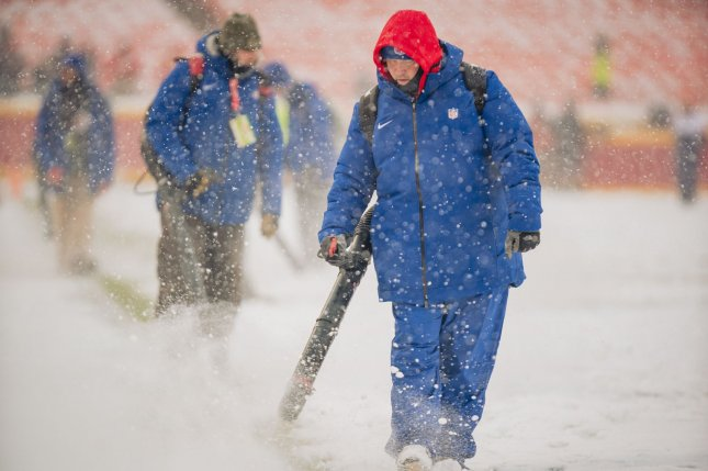 Groundskeepers clear the field of snow before the Kansas City Chiefs take on the Denver Broncos at Arrowhead Stadium in Kansas City, Mo., on Sunday. Photo by Kyle Rivas/UPI