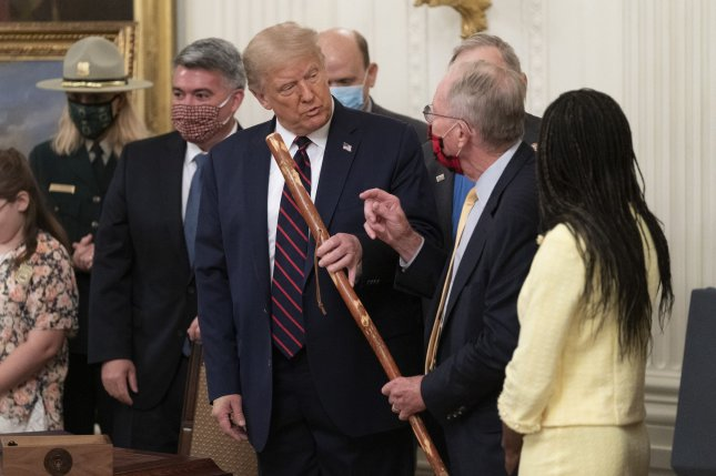 Sen. Lamar Alexander R-Tenn., hands a walking stick to Donald Trump Tuesday during a signing ceremony for The Great American Outdoors Act at the White House in Washington, D.C. Photo by Chris Kleponis/UPI