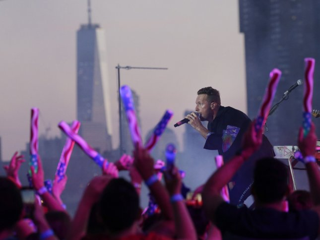 Chris Martin and Coldplay perform during a taped free concert in front of One World Trade Center and the Manhattan skyline for Macy's Fourth of July special in New York City on June 17. The band's next album will be released in October. File Photo by John Angelillo/UPI