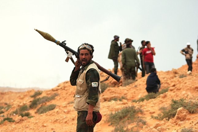 Libyan rebels take their positions after fighting with pro-Gadhafi forces in the western city of Ajdabiya, Libya on April 13, 2011. The British government reiterated its support of NATO's ongoing role in the civil war. UPI/Tarek Alhuony