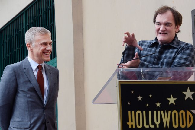 Actor Christoph Waltz (L) reacts to comments by director Quentin Tarantino during an unveiling ceremony honoring Waltz with the 2,536th star on the Hollywood Walk of Fame in Los Angeles on Dec. 1, 2014. Photo by Jim Ruymen/UPI
