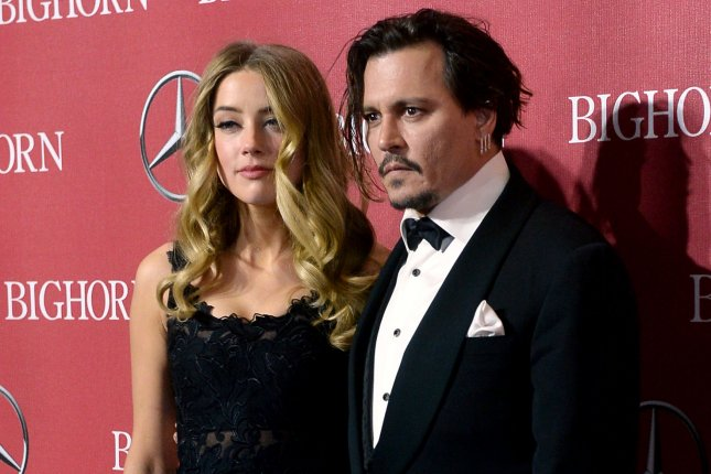 Amber Heard and Johnny Depp attending the 27th annual Palm Springs International Film Festival awards gala on January 2. After filing for divorce, Heard now accuses Depp of domestic violence and is seeking a restraining order. File Photo by Jim Ruymen/UPI