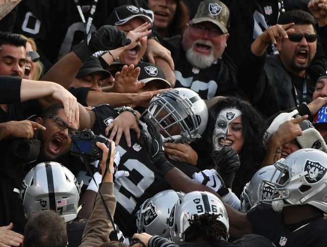 Former Oakland Raiders defensive end Khalil Mack is mobbed in the stands after intercepting a pass during a game against the Carolina Panthers in 2016. Mack was traded to the Chicago Bears on Saturday. Photo by Terry Schmitt/UPI