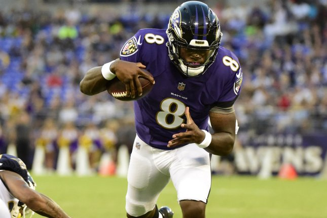 Baltimore Ravens quarterback Lamar Jackson runs a 9-yard keeper play into the end zone for a touchdown against the Los Angeles Rams during a preseason game at M&T Bank Stadium on August 9, 2018. Photo by David Tulis/UPI
