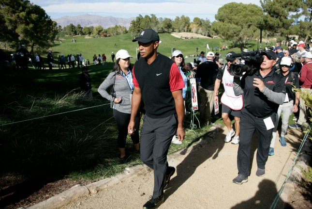 Tiger Woods is out of Match Play in Austin, Texas after missing a four-foot putt on the 18th hole Saturday that would have extended the event to extra holes against Denmark's Lucas Bjerregaard. File photo by James Atoa/UPI
