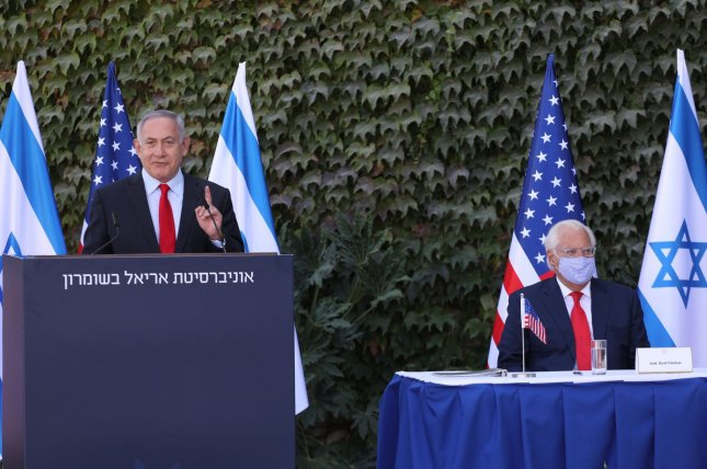 Israeli Prime Minister Benjamin Netanyahu attends a signing ceremony Wednesday with U.S. Ambassador to Israel David Friedman (R) to expand Israeli-U.S. scientific cooperation, at Ariel University in the West Bank. Photo by Emil Salman/UPI/Pool