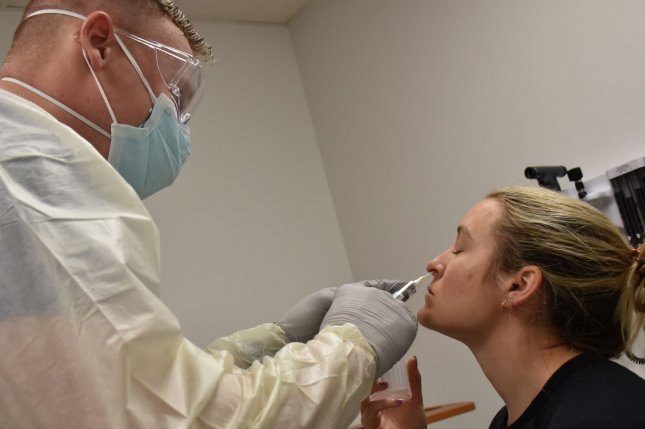 A patient is given a COVID-19 test in an urgent-care clinic. File Photo by Twana Atkinson/U.S. Army