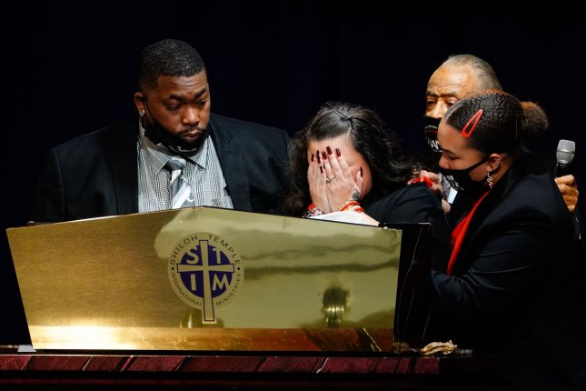 Aubrey Wright and the Rev. Al Sharpton and a family member comfort Katie Wright as she delivers remarks Thursday during the funeral for 20-year-old Daunte Wright who was shot and killed by police officer Kimberly Ann Potter during a traffic stop and attempted arrest in Brooklyn Center, Minn. Photo by Jemal Countess/UPI