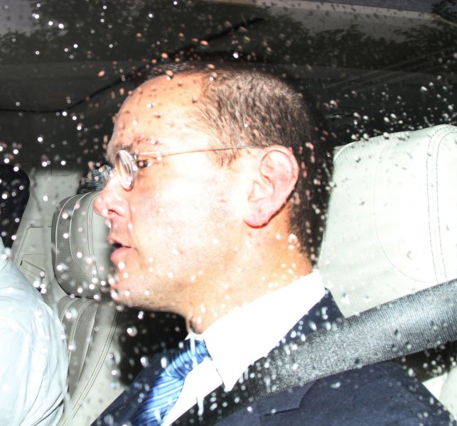 James Murdoch, deputy chief of News Corp., is pictured leaving a Government Select Committee meeting July 19, 2011. UPI/Hugo Philpott