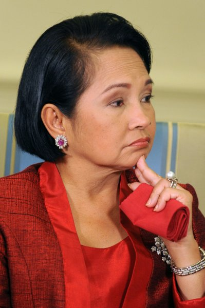 Gloria Arroyo is hospitalized and facing election-sabotage charges, is being force-fed to counteract anorexia nervosa. UPI/Michael Reynolds/Pool