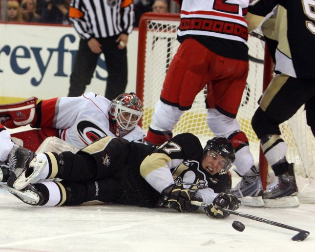 Pittsburgh Penguins Sidney Crosby (87) swings at a lose puck in front of the Carolina Hurricanes net during the second period against the Carolina Hurricanes, at the Mellon Arena in Pittsburgh on December 7, 2008. (UPI Photo/Stephen Gross)