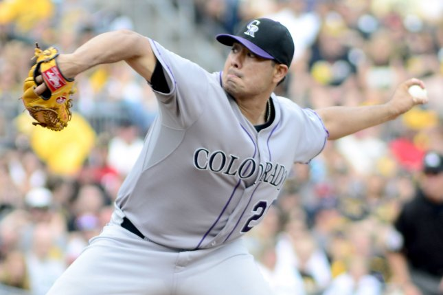 Former Colorado Rockies starting pitcher Jorge De La Rosa (29) records the win and throws into the seventh inning against the Pittsburgh Pirates at PNC Park in Pittsburgh on August 30, 2015. The Colorado Rockies defeated the Pittsburgh Pirates 5-0. Photo by Archie Carpenter/UPI