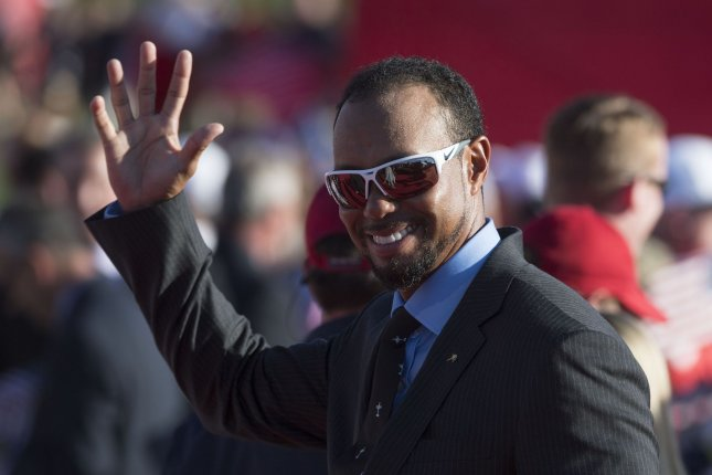 USA Team vice-captain Tiger Woods leaves the opening ceremony of the Ryder Cup at Hazeltine National Golf Club in Chaska, Minnesota. File photo by Kevin Dietsch/UPI