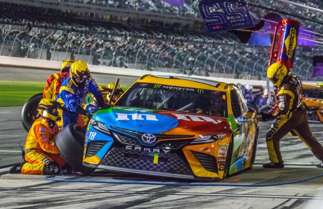 Kyle Busch pits for service late in the Can-Am Duel 1 in February in Daytona, Fla. Photo by Edwin Locke/UPI