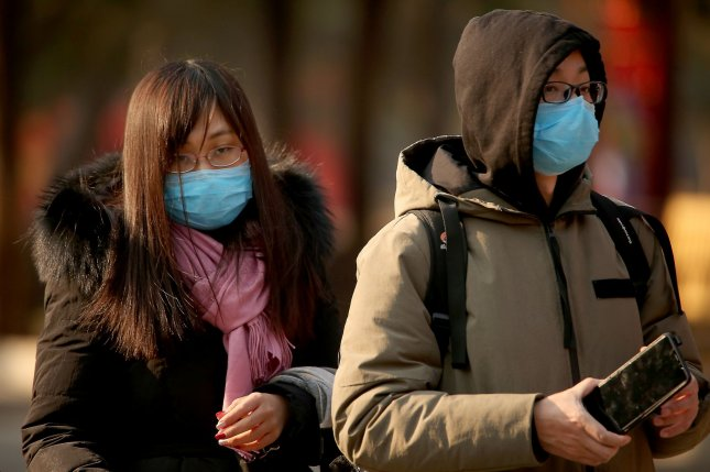 People in China, where 26 people have died of coronavirus, wear protective respiratory masks. Photo by Stephen Shaver/UPI