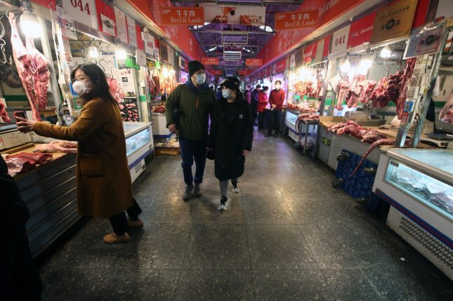 Chinese people wear protective face masks during a visit to a nearly empty market as the threat of the deadly coronavirus, spreading in Beijing, continues on Friday, February 21, 2020. Photo by Stephen Shaver/UPI