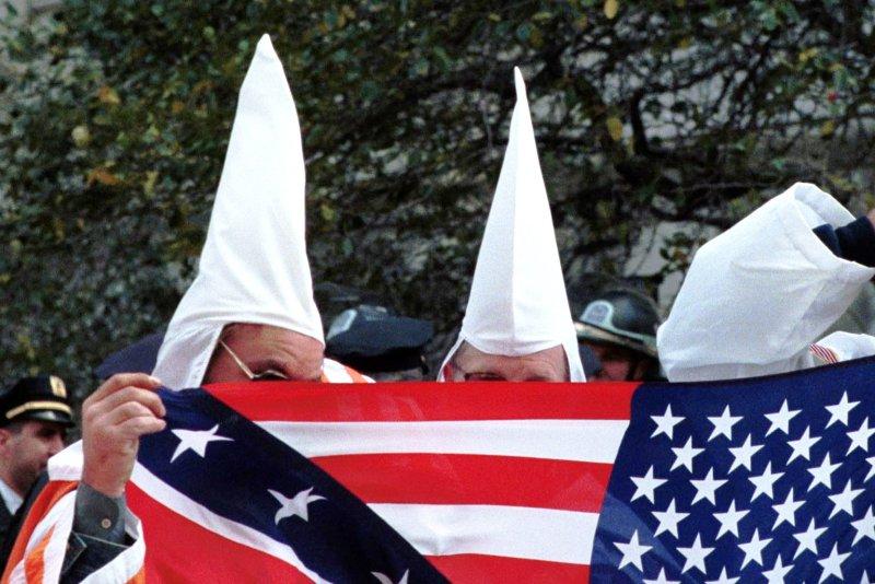 Ku Klux Klan members hide their faces (File/Ezio Petersen/UPI)