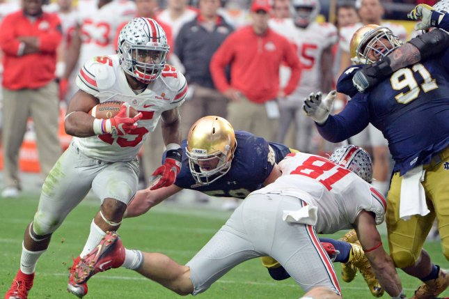 Ohio State's Ezekiel Elliott rushes for a for a first down against Notre Dame in the fourth quarter of the Fiesta Bowl at University of Phoenix Stadium in Glendale Arizona, January 1, 2016. Ohio State defeated Notre Dame 44-28. Photo by Art Foxall/UPI