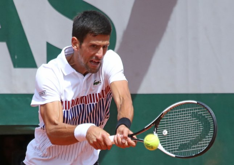 Novak Djokovic returns a shot during the French Open. Djokovic captured the Aegon International title Saturday. Photo by David Silpa/UPI