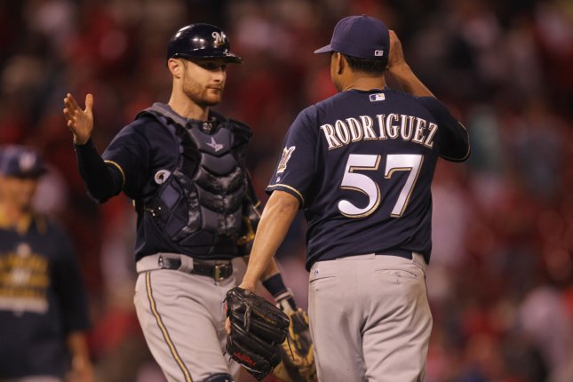 Former Milwaukee Brewers catcher Jonathan Lucroy and former pitcher Francisco Rodriguez celebrate the third out and a 1-0 win over the St. Louis Cardinals at Busch Stadium in St. Louis. File photo by Bill Greenblatt/UPI