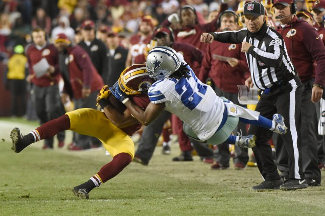 Former Dallas Cowboys free safety J.J. Wilcox (27) brings down Washington Redskins running back Chris Thompson (25) in the second quarter on December 7, 2015 at FedEx Field in Landover, Maryland. File photo by Molly Riley/UPI