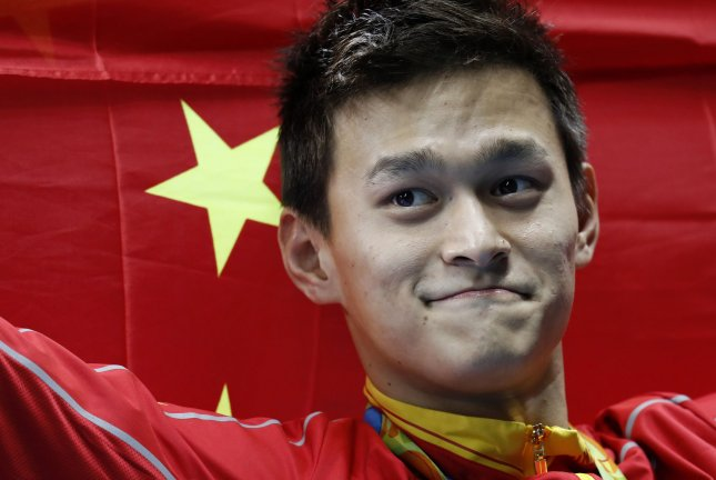 Chinese swimmer Sun Yang celebrates after winning a gold medal in the Men's 200m freestyle event at the Olympic Aquatics Stadium at the Summer Olympics in Rio de Janeiro, Brazil, on August 8, 2016. File Photo by Matthew Healey/UPI
