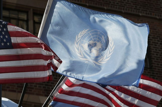 Flags of the United Nations and the United States are seen Monday outside United Nations headquarters in New York City. Photo by John Angelillo/UPI