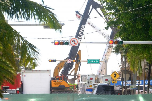 Heavy rescue equipment works on the collapsed condo building in Surfside, Fla., on Sunday. Photo by Gary I Rothstein/UPI