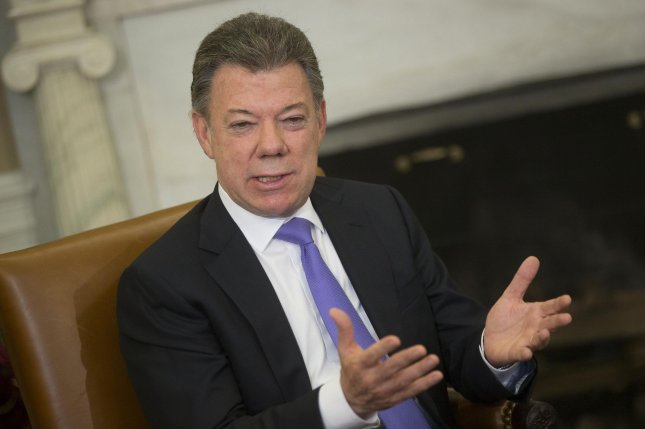 Colombia President Juan Manuel Santos, pictured in 2013, has suspended peace talks with the FARC. (UPI/Andrew Harrer/Pool)