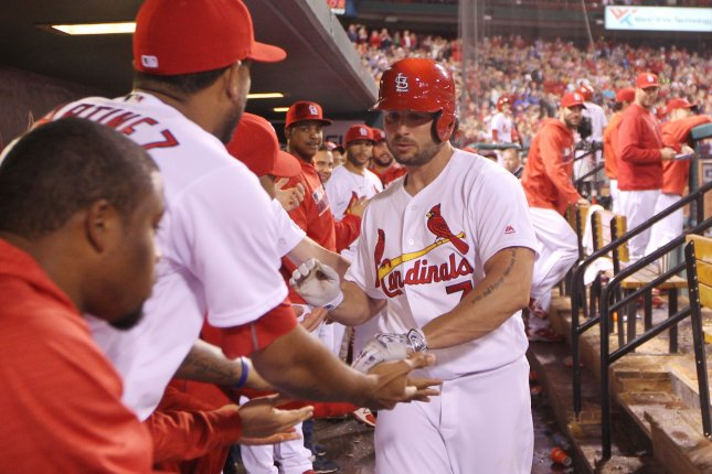 St. Louis Cardinals' Matt Holliday is congratulated after hitting a solo home run in the seventh inning against the Pittsburgh Pirates at Busch Stadium in St. Louis on September 30, 2016. Photo by Bill Greenblatt/UPI
