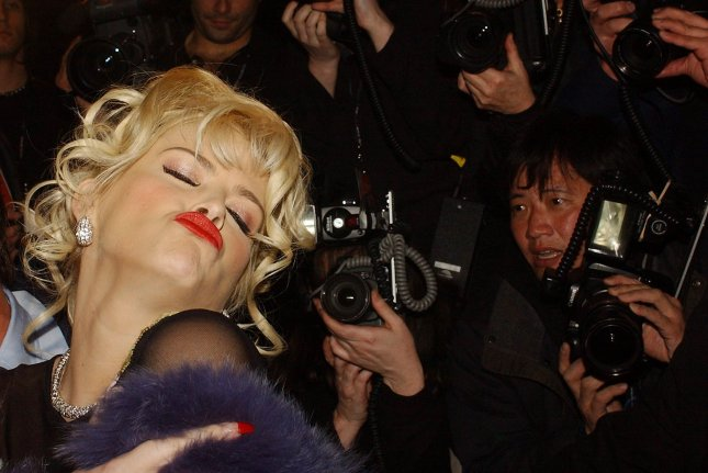 Actress Anna Nicole Smith vamps and poses for the media after attending Betsy Johnson 2004 fall-winter collection shown in New York on February 9, 2004, at Olympus Fashion week. File Photo by Ezio Petersen/UPI