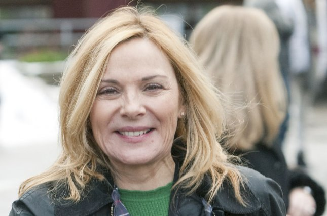 Actress Kim Cattrall leaves the Awards Brunch during the 2014 Whistler Film Festival in British Columbia, December 7, 2014. Her fan-favorite movie Mannequin was released in U.S. theaters 30 years ago Monday. File Photo by Heinz Ruckemann/UPI
