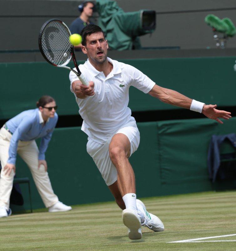 Novak Djokovic hits return during the 2017 Wimbledon championships in London. Photo by Hugo Philpott/UPI